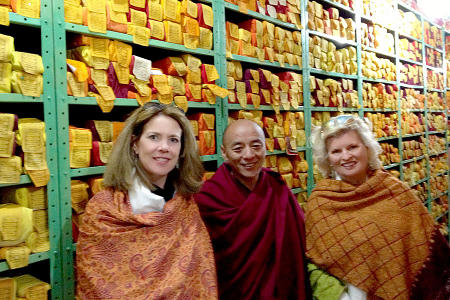 With the librarian who manages the sacred writings that have been smuggled out of Tibet at great risk. This is a temperature controlled room. 2013, With Patti Bailey.