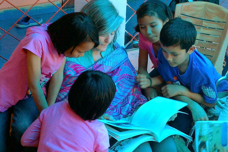 Rev. Susan Sims Smith reading to children at the CED House orphanage, Dehradun, India, 2013