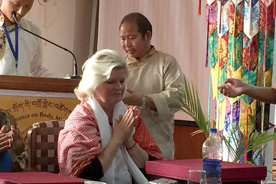 """Receiving award for presentation """"8 Ways to Wellbeing,"""" at Tibetan Medical and Astro Society conference, Dharmsala, India"""