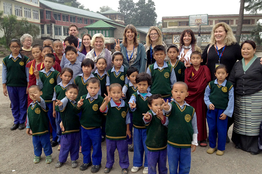 """In 2014, I accompanied 30 physicians and therapists to bring donations to the Tibetan Children's Village. Our group visited with some of the children from the """"Baby House."""""""