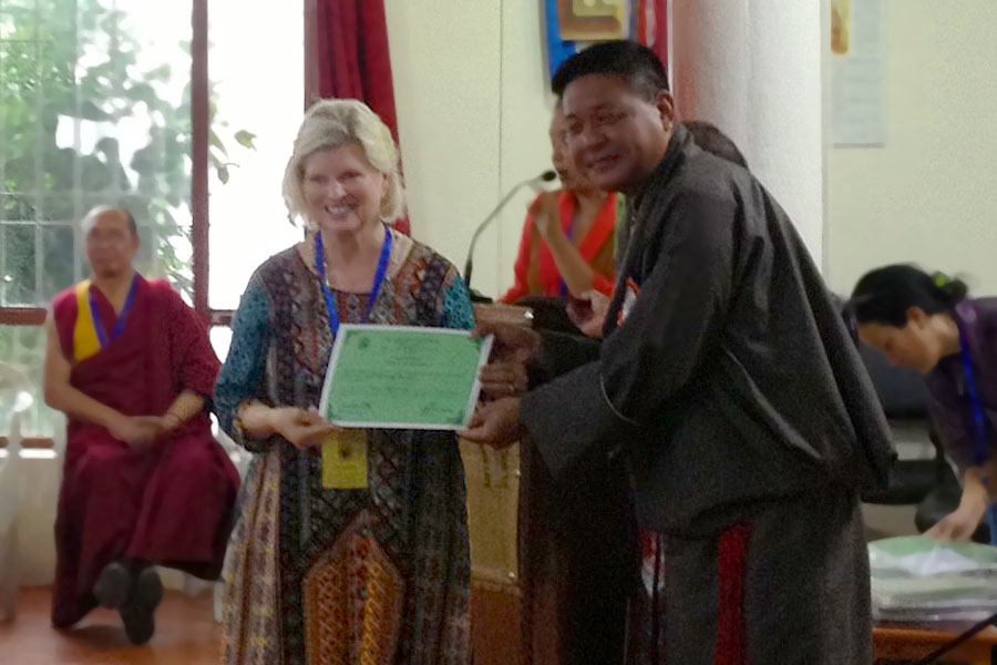 Receiving Certificate of Attendance for Men-Tsee-Khang Tibetan Medical and Astrological Society conference, Dharmsala, India, 2014