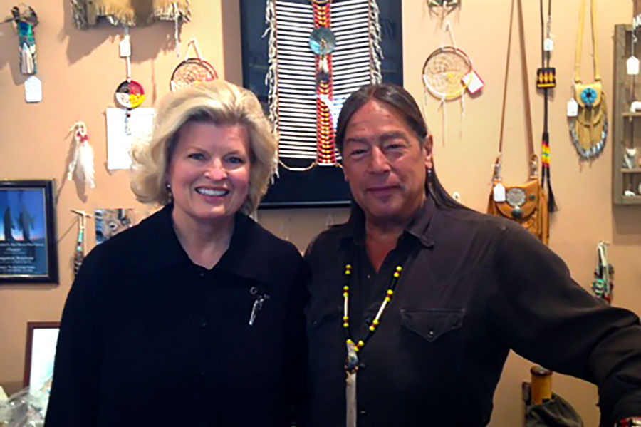 Sonnee with musician, Sky Redhawk in his shop, Native Sounds, Santa Fe, NM, 2014. It is Sky's music that can be heard on this website